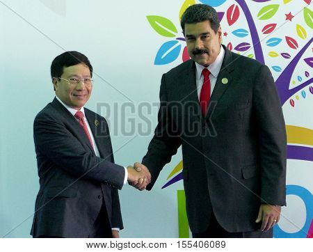 Porlamar Venezuela. September 17th 2016: Vietnamese Foreign Minister Pham Binh Minh and Venezuelan President Nicolas Maduro at the opening ceremony of the Non-Aligned Movement Summit in Porlamar Venezuela
