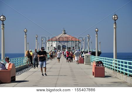 September 30 2016. Manhattan Beach California. People walking on the famous landmark manhattan beach pier in Manhattan Beach California on the pacific ocean.