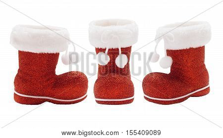 Set of empty red boots of Santa Claus isolated