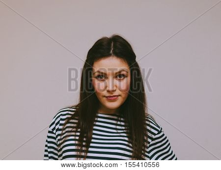 Young beautiful brunette girl in stripped frock