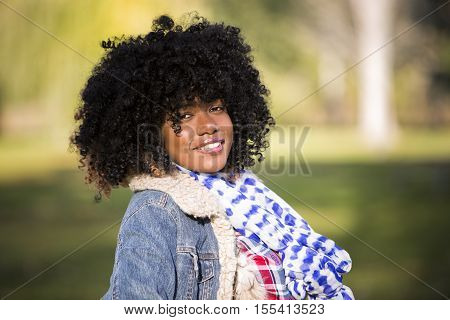 Ethnic Woman Outdoors In The Fall