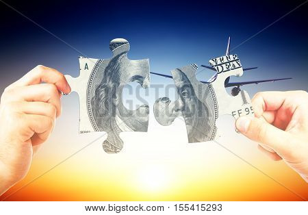 Hands putting money puzzle pieces together on bright background. Business challenge concept