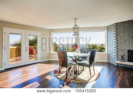 Bright Sunny Dining Room With Hardwood Floor