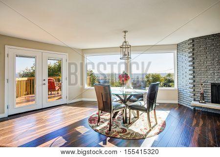 Bright Sunny Dining Room With Hardwood Floor