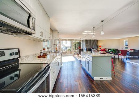 Bright Interior Of Kitchen With Large Kitchen Island