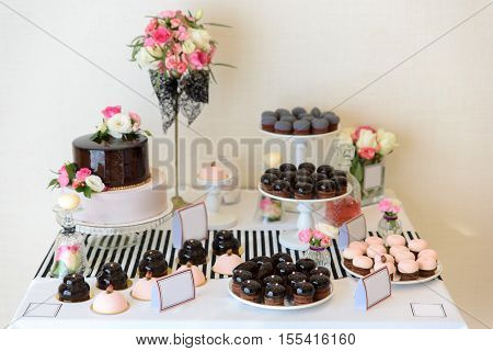 Beautiful desserts, sweets and candy table at wedding reception ot other event.