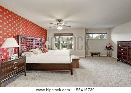 Master Bedroom Interior With Large Bed And Red Wall