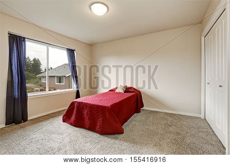 Single Red Bed In Empty Bedroom On The Second Floor
