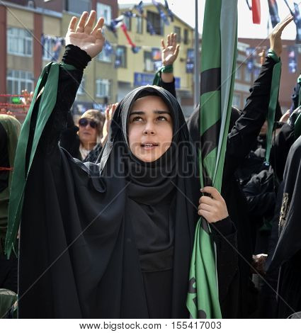 Istanbul Turkey - October 11 2016: Muslims worldwide marks Ashura Istanbul Shiite community. Turkish Shia Muslims mourning for Imam Hussain. Caferis take part in a mourning procession marking the day of Ashura in Istanbul's Kucukcekmece district Turkey on