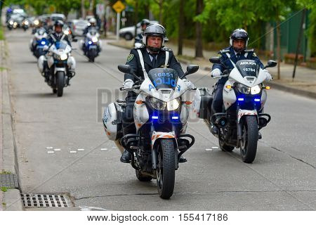 Olivos, Argentina - Oct 24, 2016: Police motorcycle escort near the official residence of the President of Argentina Quinta de Olivos.