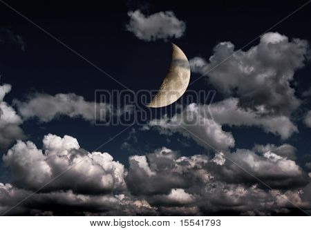 crescent and many clouds in night sky