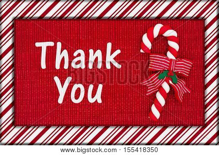 Christmas thank you message Red shiny fabric with a candy cane and candy cane border with text Thank You 3D Illustration