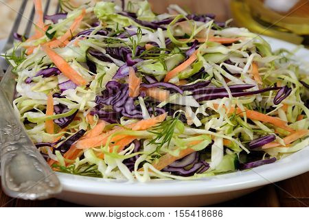 Salad coleslaw red and white cabbage with carrots and cucumber