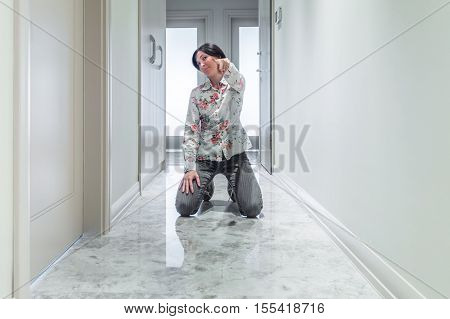 Young Woman Bending On Her Knees At The Corridor