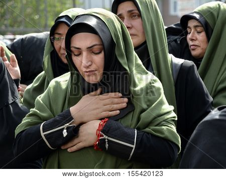 Istanbul Turkey - October 11 2016: Shia Muslim women mourn during Ashura. Turkish Shia Muslims mourning for Imam Hussain. Caferis take part in a mourning procession marking the day of Ashura in Istanbul's Kucukcekmece district Turkey on October 11 2016. C