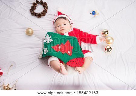 Asian Infant Baby in santa costume christmas celebration