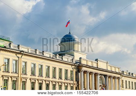 Fasade of Leningrad Regional Court building on the Fontanka River in Saint Petersburg Russia - closeup facade view with Russian flag on the roof flagpole in sunny day