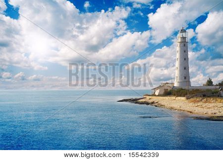 Old lighthouse on sea coast poster