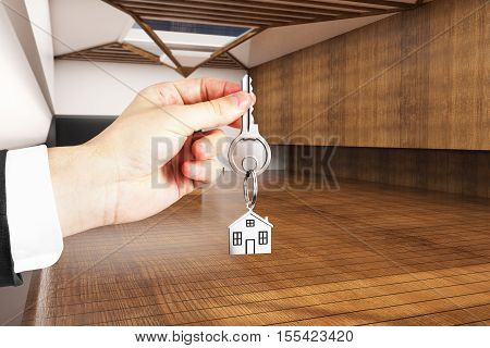 Hand holding key with house keychain in modern wooden interior. 3D Rendering. Real estate and mortgage concept