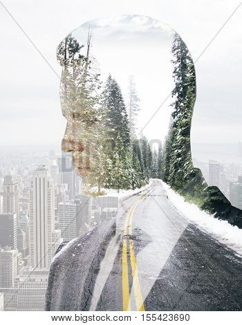 Side portrait of man on road landscape and city background. Double epxosure