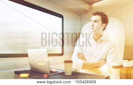 Man Travelling In Train Compartment, Toned
