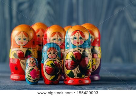 Family of matreshka on blue wooden table