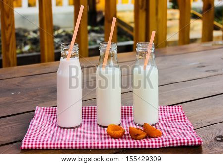 bottle of milk and bubble tea in a glass bottle on the background of the river