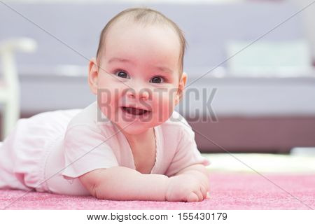 Sweet Baby Is Crawling On Carpet And Smiling