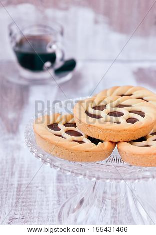 Mini Sweet Pie Tarts (Crostata) on white wooden background, Recipes Sweet Tarts. Delicious Italian Sweet Nutella Chocolate Tarts (Crostata alla Nutella) on white wooden background, Recipes Sweet Tarts