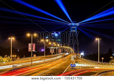 "8. october 2016 - Bratislava Slovakia: White night - contemporary art festival of lights. Light art installation called ""lighthouse"" on SNP bridge."