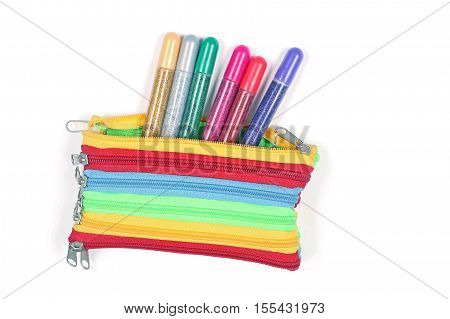 Colorful pencil box with glitter pens peeking outside
