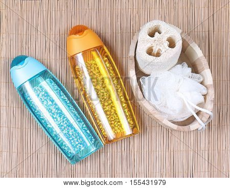 Bath sponges set with glittering toiletries containers