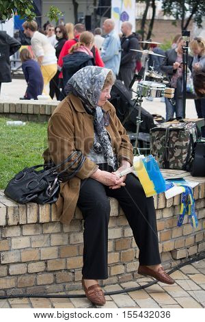 Kiev Ukraine - May 21 2016: Elderly woman sells symbols of Ukraine and the European Union during the celebration of Europe Day