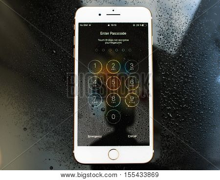 PARIS FRANCE - SEP 26 2016: New Apple iPhone 7 Plus unboxing and testing - enter passcode afer touch id did not recognised fingeprint. New iPhone7 is one of the best waterproof smart phone in the world