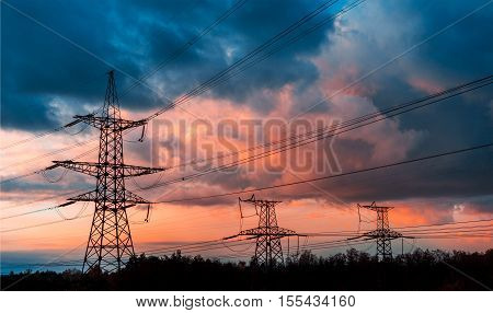 electrical power line against cloud and blue sky.