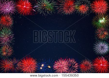 Amazing celebration sparkling fireworks over starry sky frame. Independence Day Christmas New Year holidays salute. 4th of July beautiful fireworks. Copy space.