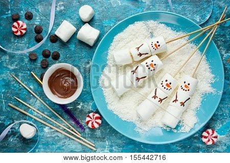Snowman marshmallow pops Christmas food art idea top view