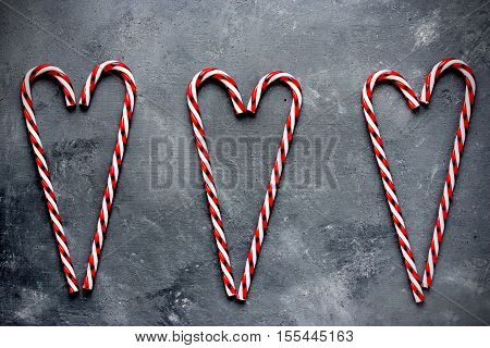 Candy cane hearts holiday background top view