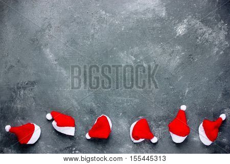 Christmas background with santa hat border blank space on a gray grunge background