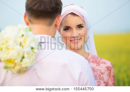 Wedding Muslim Couple During The Marriage Ceremony.