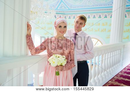 Islamic Couple In The Mosque On A Wedding Ceremony