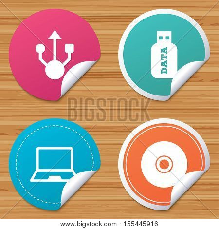 Round stickers or website banners. Usb flash drive icons. Notebook or Laptop pc symbols. CD or DVD sign. Compact disc. Circle badges with bended corner. Vector