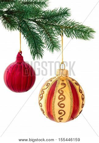 Set of red and gold balls hanging on tree. Isolated on white background.