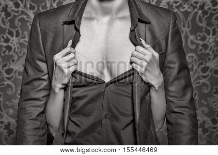 Woman hands undress rich man body sexuality closeup black and white