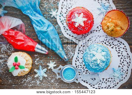 Happy New Year and Merry Christmas Background - Christmas cupcakes decoration process top view
