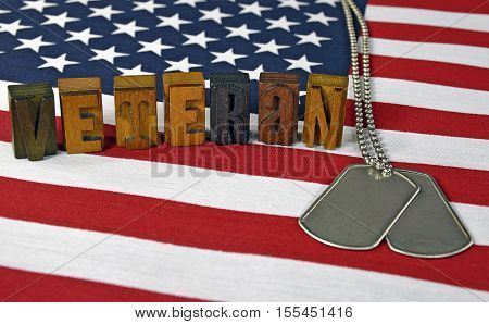military veteran dog tags on flag with vintage wooden letterpress type