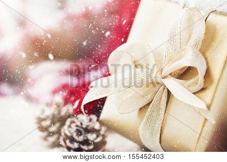 Golden gift boxes with beautiful ribbon and bow on a bright shiny background holiday concept horizontal with copy space