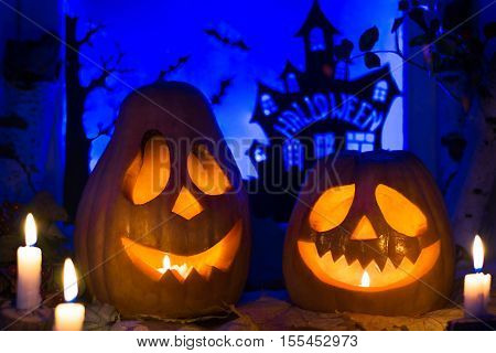 Halloween pumpkins and autumn leaves. Halloween pumpkin lanterns.