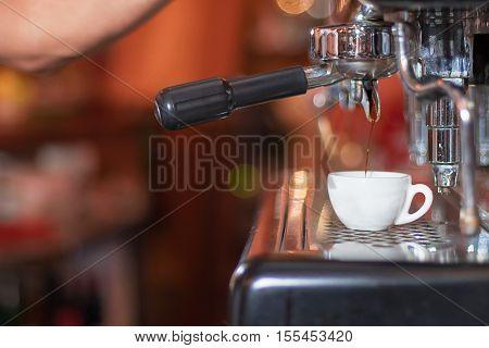 Espresso Machine Making Coffee, Golden Espresso Flowing. Coffee Espresso