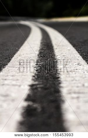 Close Up View Of Road Lane Markings On Asphalt Road